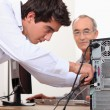 Man fixing a computer - Stock Photo