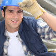 Smiling construction worker wearing a hardhat — Stock Photo