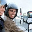 Couple on scooter in a crossroad - Stockfoto