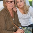 Stock Photo: Grandmother and granddaughter painting