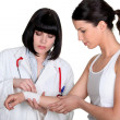 Stockfoto: Doctor bandaging patient's wrist