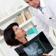 Stock Photo: Doctor and assistant watching an x-ray