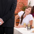 Stock Photo: Man offering gift to woman in restaurant