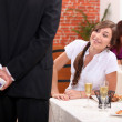Man offering gift to woman in restaurant — Stock Photo