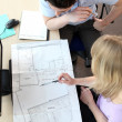 Colleagues looking at architect drawings — Stock Photo