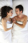 Couple lying in bed together — Stock Photo