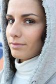 Woman wearing hooded coat — Stock Photo