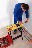 Electrician fixing breaker box — Stock Photo