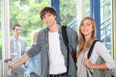 Students at college entrance — Stock Photo