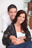 Good looking man holding his wife at home — Stock Photo