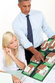 Architects looking at a building model — Stock Photo