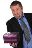 Man with gift package — Stock Photo
