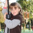 Small girl in roundabout - Stock Photo
