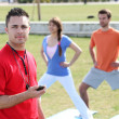 Personal trainer with his clients - Foto Stock