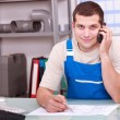 Plumbers merchant on the telephone — Stock Photo