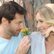 Stock Photo: Husband smelling flower