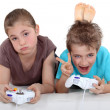 Stock Photo: Children playing computer games