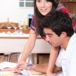 Stock Photo: Young couple in kitchen before work