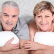 Mature couple in bed — Stock Photo #8390567