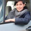 A woman driving a car — Stock Photo