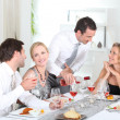 Friends having a dinner party — Stockfoto