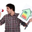 Stock Photo: Young mscreaming in bullhorn