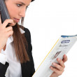 Woman calling an advert in a magazine — Stock Photo #8394644