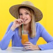 Woman drinking fresh juice with a straw — Stockfoto