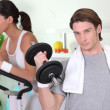 Young couple in gym — Stock Photo #8396840