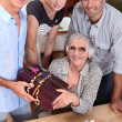 Family celebrating mother's birthday, she's about 70 years old — Stockfoto