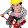 Womwith nippers sitting on toolbox — Stock Photo #8397067