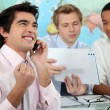 Stock Photo: Young businessmrejoicing
