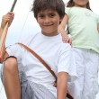 Stock Photo: Children doing archery