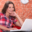 Relaxed woman using her laptop — Stock Photo #8397798