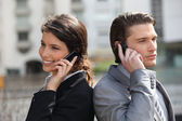 Business partners taking on the cell — Stock Photo