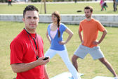 Personal trainer with his clients — Stock Photo