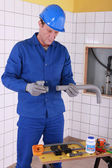 45 years old plumber connecting pipes — Stock Photo