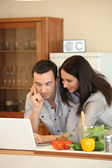Couple looking at laptop — Stock Photo