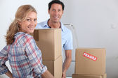 Couple moving boxes — Stock Photo