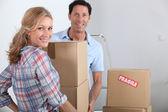Couple moving boxes — Stock Photo