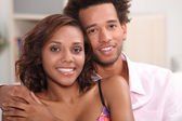 Young African couple at home — Stock Photo