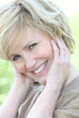 Closeup of radiant smiling woman — Stock Photo