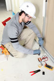 Man repairing house wiring — Stock Photo