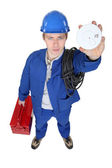Electrician holding up smoke alarm — Stock Photo