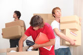 Young men moving house — Stock Photo