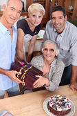 Family celebrating mother's birthday, she's about 70 years old — Stock Photo