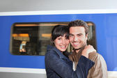Couple embracing on the train station — Stock Photo