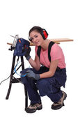 Woman with an electric saw — Stock Photo