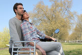 Young couple on scooter — Stock Photo