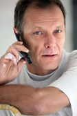 Portrait of mature painter making a call — Stock Photo